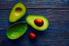 Avocado cut on aged wood table board Stock Photography