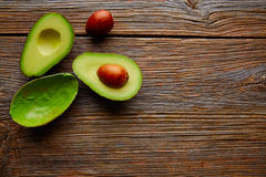 Avocado cut on aged wood table board Royalty Free Stock Photo