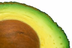 Avocado cut closeup, macro isolated Royalty Free Stock Photography