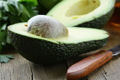 Avocado cut in hal Royalty Free Stock Photos