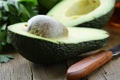 Avocado cut in hal Royalty Free Stock Photos