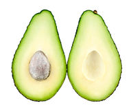 Avocado cut in half. On white background royalty free stock images