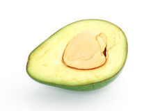 Avocado cut in half with the pit Royalty Free Stock Photo