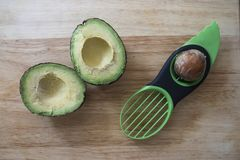 Pitting an Avocado stock photo