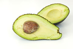 Avocado, cut in half ,  on white Stock Images