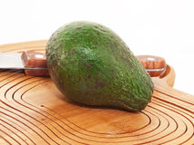 Avocado at the cutting board Royalty Free Stock Photo