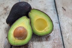 Avocado on a dark wood background stock photo
