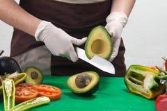 Avocado e cuoco Fotografia Stock Libera da Diritti