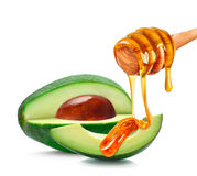 Avocado e miele Fotografia Stock