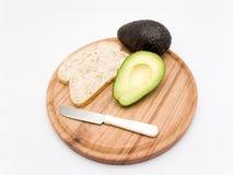 Avocado e pane affettato immagini stock