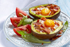 Avocado Egg Boats with bacon Royalty Free Stock Image