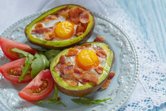 Avocado Egg Boats with bacon Royalty Free Stock Images