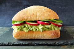 Avocado, egg salad sandwich on a ciabatta bun over state Stock Photo