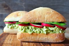 Avocado, egg salad sandwiches on a ciabatta bun Royalty Free Stock Photo