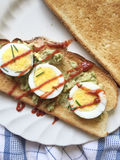 Avocado and egg sandwich with Sriracha Royalty Free Stock Photography