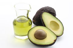 Avocado en avocadoolie stock afbeelding