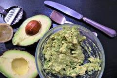 Avocado en citroen stock afbeeldingen