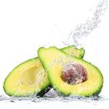 Avocado falling in water. Fresh avocado falling in water stock photo