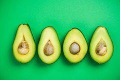 Avocado flat lay on green pastel background. Food concept Royalty Free Stock Photography