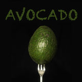 Avocado on fork Royalty Free Stock Photo
