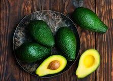 Avocado. Fresh green avocado on the wooden table stock photo