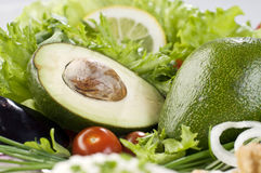 Avocado with fresh greens close-up Stock Image