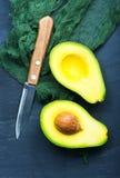 Avocado. Fresh avocado on a table, green avocado stock photo