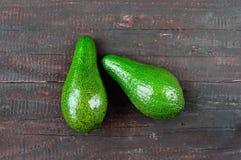 Avocado. Fresh avocado  on wood table background. Tasty and health vegetable. Exotic fruit Stock Photos