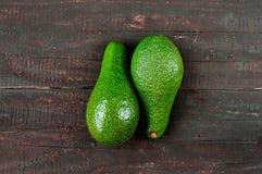 Avocado. Fresh avocado  on wood table background. Tasty and health vegetable. Exotic fruit Royalty Free Stock Photo