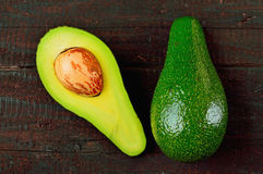Avocado. Fresh avocado  on wood table background. Tasty and health vegetable. Exotic fruit Royalty Free Stock Photos