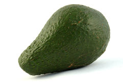 Avocado fruit. An African green avocado fruit. Image isolated against a white studio background Royalty Free Stock Photo