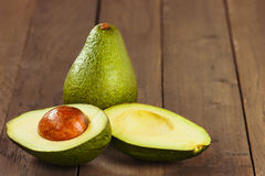 Avocado fruit on brown wooden old table Royalty Free Stock Image