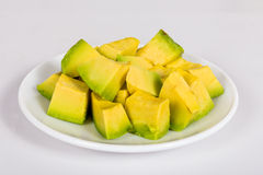 Avocado fruit. Chopped up on a white dish Stock Photography