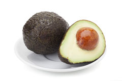 Avocado fruit. Isolated on white background with clipping path and soft shadow Stock Photography