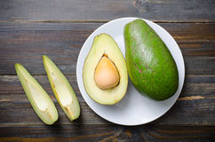 Avocado fruit. Ready to eating on wooden background,Healthy food Royalty Free Stock Photography