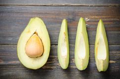 Avocado fruit. Ready to eating on wooden background,Healthy food Stock Photos