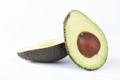 Avocado fruit on white Stock Images
