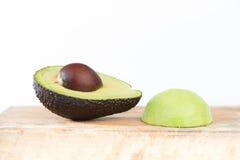Avocado fruit on wood Royalty Free Stock Images