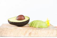 Avocado fruit on wood Stock Photography
