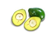 Avocado fruits sliced in half on white background. Stock Photo