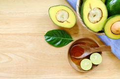 Avocado fruits on a wood background. Royalty Free Stock Photos