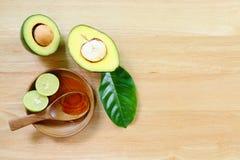 Avocado fruits on a wood background. Stock Image
