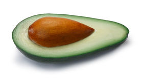 Avocado fuerte half  Persea americana, paths. Avocado Fuerte, half with seed Persea americana. Clipping paths, shadow separated Stock Photography