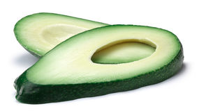 Avocado fuerte slices Persea americana, paths. Avocado Fuerte slices Persea americana. Clipping paths, shadow separated Stock Photo