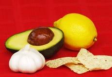 Avocado, garlic, lemon, chips Royalty Free Stock Photos