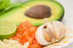 Avocado, garlic, tomato, lime Stock Photos