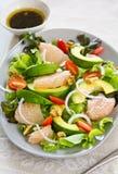 Avocado,Grapefruit and walnut salad Royalty Free Stock Images