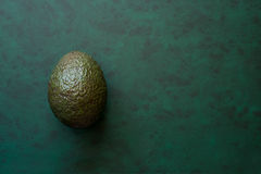 Avocado on Green Background with Copy Space Royalty Free Stock Photography