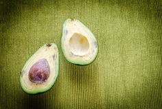 Avocado on the green background Stock Photography