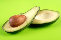 Avocado. On green background - studio shot Stock Photography
